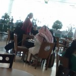 Man in keffiyeh at Doha airport